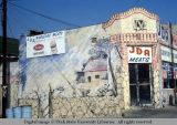 Mural on wall of meat market, Los Angeles, California, 1978