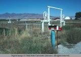 Mailbox and panoramic view of Walter Jones Ranch, Malad, Idaho, 1978