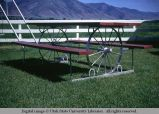 Buggy wheel as picnic table support, Logan, Utah, 1968