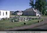 Wagon wheels as yard ornaments, Evanston, Wyoming, 1965