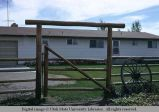 Modern pole fence and gate, St. Anthony, Idaho, 1973