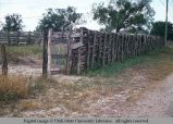 Pole fence with double vertical poles, Texas, 1968