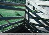 Pole fence and board gate, east of Oakley, Utah, 1977