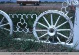 Fence of wheels and horseshoes, Highway 26, west of Ririe, Idaho, 1979