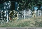 Fence of horseshoes and wagon wheels, Orovada, Nevada, 1977