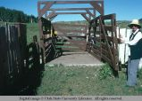 Gate to cattle loading ramp, east of Oakley, Utah, 1977