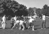 Students playing intramural football on the Quad, 1950s