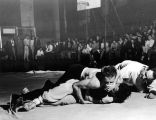 Students wrestling in an intramural match, 1950s