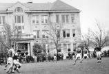 Students participating in a soccer game on the Quad, 1940s