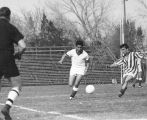 Students playing a soccer game, old Romney Stadium, 1960s