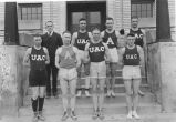Coach Dick Romney with seven members of the 1920 track team