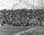 Crowd in the stands at Romney Stadium for a football game, 1950s
