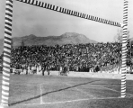 Interior of Old Romney Stadium during a football game, 1930s