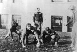 Agricultural College of Utah football team scrimmaging on the lawn west of Old Main, 1906