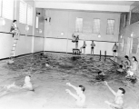 Students swimming in the Smart Gymnasium swimming pool, 1960s