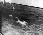 Students swimming in the Smart Gymnasium swimming pool, 1950s