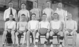 Basketball coach and team members, circa 1920