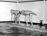 Two students poised to dive, 1950s