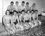 Eleven swim team members pose at the side of the pool, Smart Gymnasium, 1950s