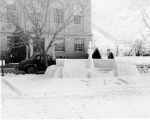 Sigma Alpha Epsilon snow sculpture of a hand holding a torch at the Winter Carnival, 1941-42