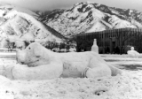 Snow sculpture of a dog at the Winter Carnival, 1950s