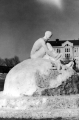 Snow sculpture of a man putting on ice skates, at the Winter Carnival