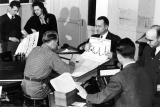 Six people looking at various charts, circa 1946