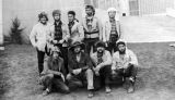Group of men dressed as trappers posing outside of the Student Union buiding, 1960s