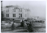 Old Main building, west section with center section under construction, early spring, 1902