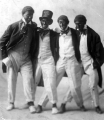 Students dressed in blackface for a minstrel show, circa 1904
