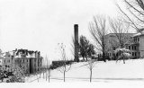 Winter scene of University Annex, Heating Plant, and Smart Gymnasium, 1920s