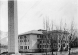 Campus looking north showing Smart Gymnasium and smoke stack of Heating Plant, 1920s