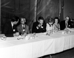University President Daryl Chase and his wife Alice sitting at a banquet table, 1960s
