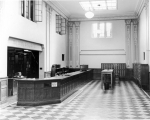 Loan desk and interior of Merrill Library, 1930s
