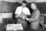 Walter H. Wilde demonstrates to Dr. G. F. Knowlton his leaf hopper cage, 1950s