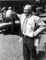 Entomology professor G. F. Knowlton holding a hive, 1950s