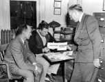 W. E. Peay and H. E. Dorst discuss with Dr. G. F. Knowlton leaflets on entomology being published...