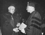 E.L. Romney receiving honorary doctorate degree, 1960
