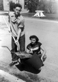 Two students on the grounds crew working in front of the library, 1950s