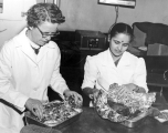 Ethelwyn B. Wilcox preparing an experiment in nutrition class, 1960s