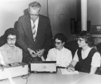 Heber C. Sharp working with three students in Psychology class , 1960s