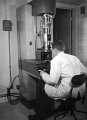 Dr. George W. Cochran using an electron microscope, 1949