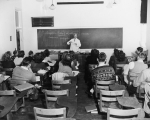 Whitney Smith teaching bacteriology class, 1950s