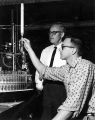 Student and an instructor looking at an experiment, 1950s