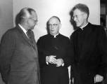 Reverend Robert J. Dwyer with President Daryl Chase and Monsignor Jerome Steffel