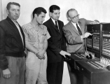 University President Daryl Chase inspecting the University switchboard, 1960s