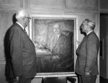 University President Daryl Chase and Alma Sonne inspecting a painting, 1960s