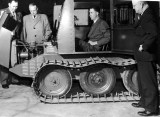 University President Chase with former USAC President Peterson inspecting the Thiokol Trackmaster,...