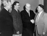 University President Daryl Chase with former USAC President E. G. Peterson and two other men, 1950s