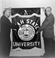 University President Daryl Chase and Mark Neuberger showing the new seal, 1957